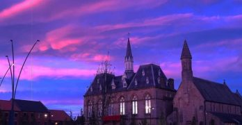 A view of Bishop Auckland Town Hall at sunset