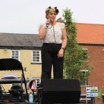 Vocalist performing on stage at 1940s Day