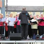 Soundwaves Community Choir on stage at the 1940s event