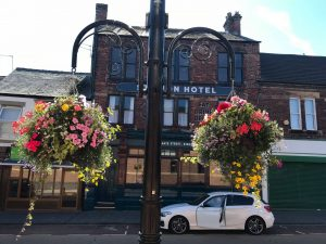 Hanging Baskets in bloom outside of the Station Hotel