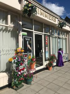 A colourful floral display outside of Trimmers