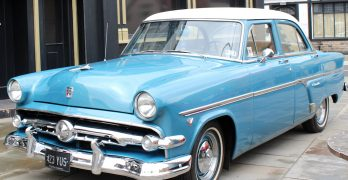 A light blue classic car