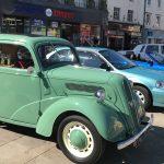 A light green classic car