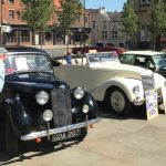 A selection of classic cars in the Market Place