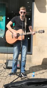 Buskers Day performance by Bradley Thompson on an acoustic guitar