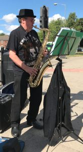 Buskers Day performance by Jimmy Robinson playing the saxophone