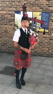 Buskers Day performance by Kenny the Bishop Piper