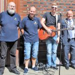 Town Team volunteers, Nigel Bryson and Lee Brownson with Mayor, David Fleming a Busker