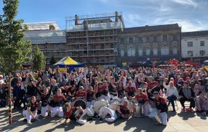 Performers from Jack Drum Arts 'Runaway Samba' posed with the crowd at Bishop Celebrating Together