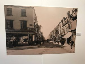 A vintage black and white photograph of Newgate Street on display