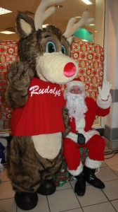 Santa Claus and Rudolph mascot in a red T-shirt