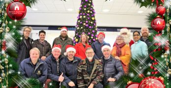 Group photo a Festive border; Town Team volunteers in the Newgate Shopping Centre