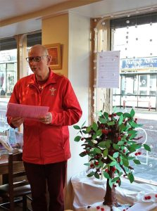 Advent Window Storyteller from the Princes Trust inside the Chocolate Cafe