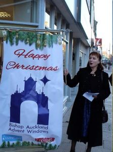 Advent Window Storyteller outside of Peacocks Store