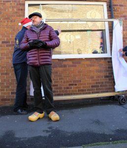 Advent Window Storyteller outside of Rio Bar