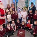 Santa Claus with children from St Wilfrid's RCVA Primary School