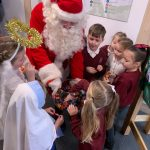 Santa Claus giving out sweets to the children