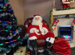 Santa Claus sat in his Grotto at the Kings Cafe