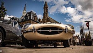 A ground level view of cream colour Jaguar E Type