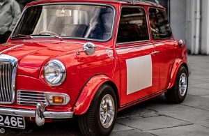 A classic Red Mini contrasted with a black and white background
