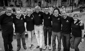 A black and white group photo of Town Team volunteers
