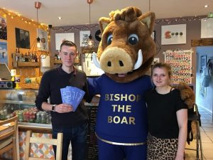Bishop the Boar with two staff members of the cafe