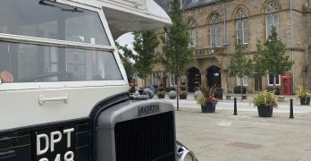 A black and white Leyland bus in the Market Place