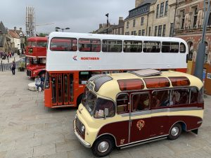 A collection of vintage buses in the Market Place