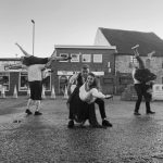A black and white of a dance performance in the Market Place