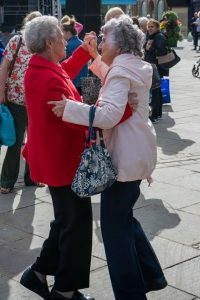 Two ladies dancing in the Market Place at Bishop Celebrating Together