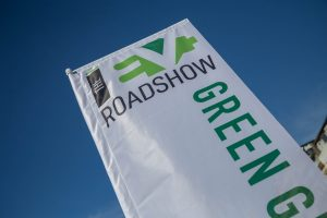 The EV Roadshow banner with blue sky