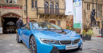A blue BMW i8 parked outside of Bishop Auckland Town Hall