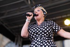 Jenna Highfield singing on stage at Bishop Celebrating Together event