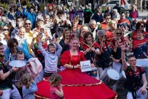 A crowd of people posed with Runaway Samba entertainers at the Bishop Celebrating Together event; #LoveBishopAuckland