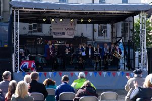 Performance by St Johns School Band on stage