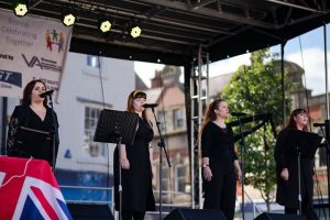 A performance Saved By The Belles on stage