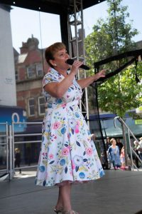 Performance by Yvonne Slater on stage