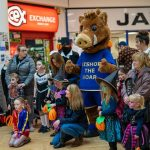 Bishop the Boar with children dressed in Halloween costumes