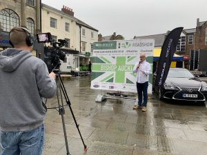 A presenter and camera crew making a recording Live from the EV roadshow