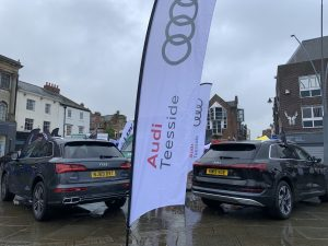 A white Audi Teeside feather banner with two Audi cars in the background
