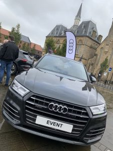 A gloss black electric Audi car in the Market Place
