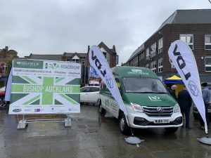 A white and green EV Roadshow electric van in the Market Place