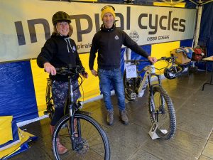 Gary and Fiona from Inspiral Cycles in the marquee with display of electric bicycles
