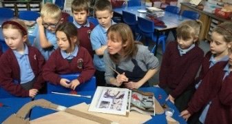 Group of school children with Laura Brenchley, making their AlterNATIVITY display