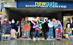 Day 24; Christmas Eve Parade assembled outide of entrance to Newgate Shopping Centre